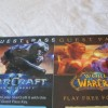 Closeup of Blizzard game passes (SCII and WoW).