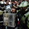 Student Justin Lau, 16, stands proud with Master Chief as he receives his Halo: Reach Legendary Edition