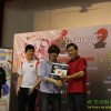 Xian receiving the top prize from Yam Ah Mee at the EVO 2012 Southeast Asia Major