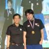 "Bryan ""nirvAnA"" Choo (R) won the gold medal at the 2011 WCG Singapore National Finals StarCraft II event"